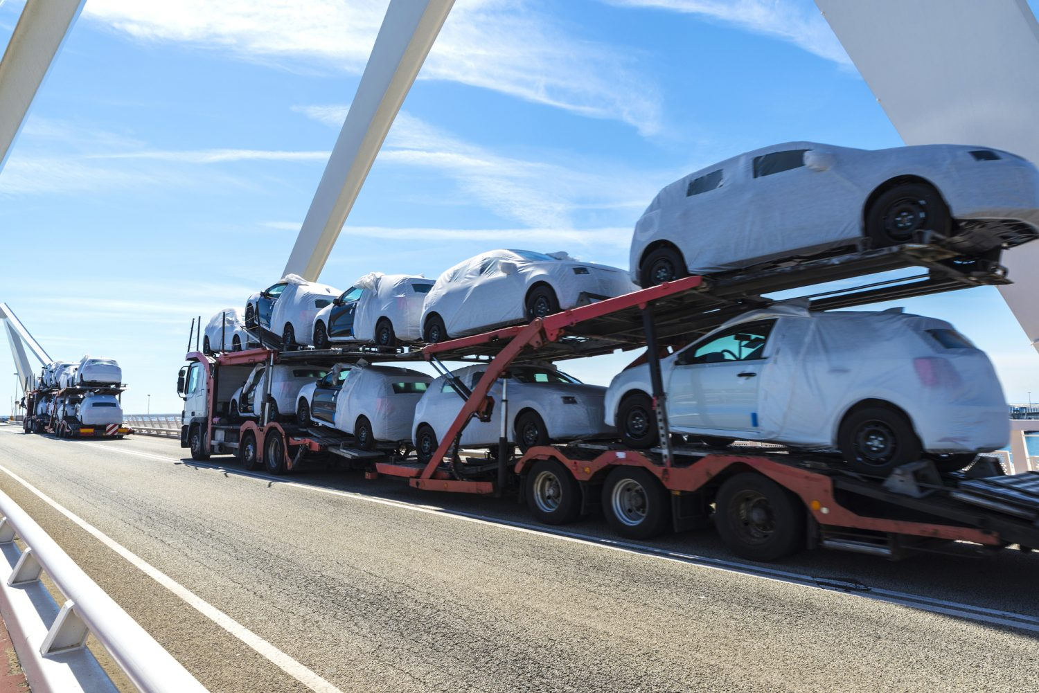 Trucks carrying new cars
